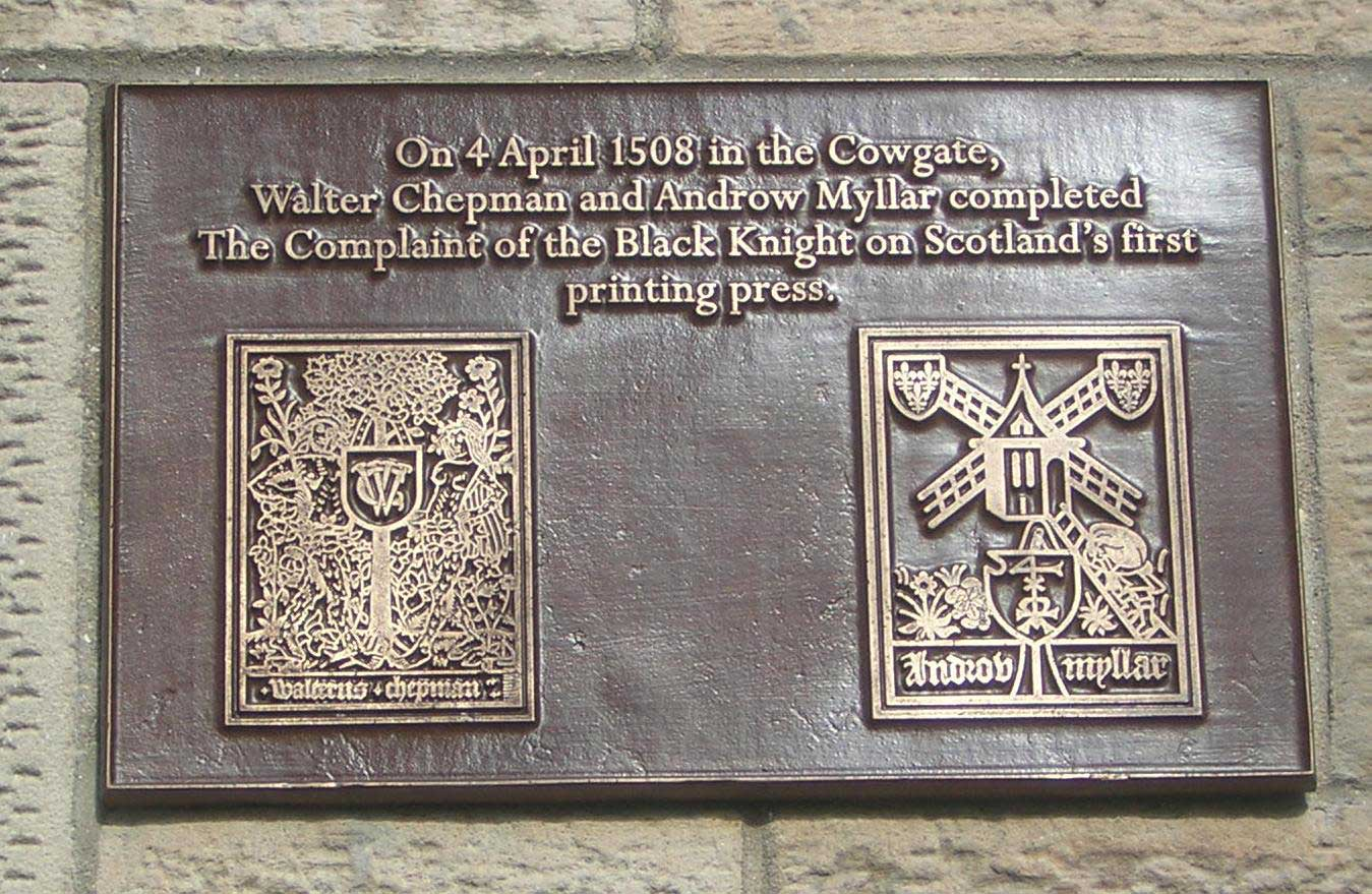 Image of plaque to commemorate the first printed book in Scotland